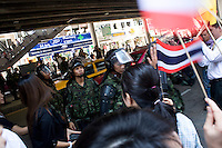 Members of special thai police are welcomed by pro-government militants this monday April 19 at Silom, in  front of the red Shirts barricade. The same day Yellow shirts organized a demonstration in this financial area. They threatened to march against red camp if nothing happen within a week.