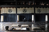 The walls of the 'Zashiki' or formal living space are hung with a traditional Edo-period banner