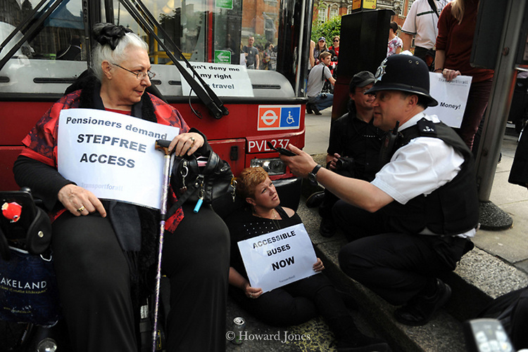 Disability rights activists stage a direct action to highlight the inaccessibility of many London busses. London, Westminster 19th June 2012