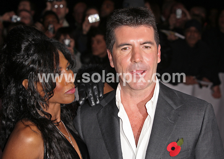 **ALL ROUND PICTURES FROM SOLARPIX.COM**.**WORLDWIDE SYNDICATION RIGHTS**.Guests attend the 2007 National Television Awards at the Royal Albert Hall, Kensington, London. 31st October 2007..This pic: Sinitta and Simon Cowell..JOB REF: 5242 SSD     DATE: 31_10_2007.**MUST CREDIT SOLARPIX.COM OR DOUBLE FEE WILL BE CHARGED* *UNDER NO CIRCUMSTANCES IS THIS IMAGE TO BE REPRODUCED FOR ANY ONLINE EDITION WITHOUT PRIOR PERMISSION*