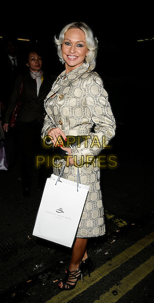KRISTINA RIHANOFF.Nick Ede's Disco Birthday Party at 24 London Club, London, England. .April 30th, 2009 .full length beige gold pattern jacket coat clutch bag black goody.CAP/CAN.©Can Nguyen/Capital Pictures.