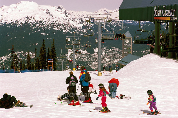 Young Children learning to Downhill Ski with Family, on Blackcomb Mountain at Whistler Resort, in the Coast Mountains, Whistler, British Columbia, Canada