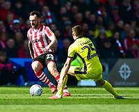 Lincoln City's Neal Eardley gets past Cheltenham Town's Jordan Tillson<br /> <br /> Photographer Andrew Vaughan/CameraSport<br /> <br /> The EFL Sky Bet League Two - Lincoln City v Cheltenham Town - Saturday 13th April 2019 - Sincil Bank - Lincoln<br /> <br /> World Copyright &copy; 2019 CameraSport. All rights reserved. 43 Linden Ave. Countesthorpe. Leicester. England. LE8 5PG - Tel: +44 (0) 116 277 4147 - admin@camerasport.com - www.camerasport.com