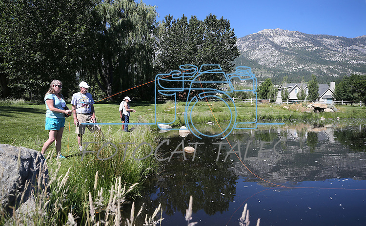 Breast cancer survivor Stella McEleney learns to flyfish with guide Marty Wright during a Casting for Recovery retreat in Gardnerville, Nev., on Friday, June 30, 2017. <br /> Photo by Cathleen Allison/Nevada Photo Source