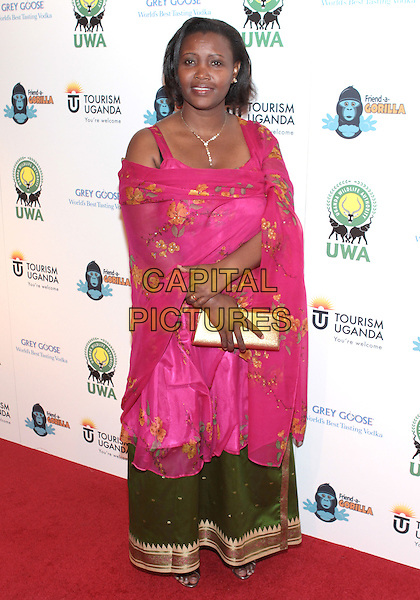 """EUNICE MAHORO .Attending """"A Rumble In The Jungle Concrete Gala"""" held at Sony Studios, Culver City, California, USA, .7th December 2009..full length pink green print floral dress wrap shawl skirt .CAP/ADM/TC.©T. Conrad/AdMedia/Capital Pictures."""