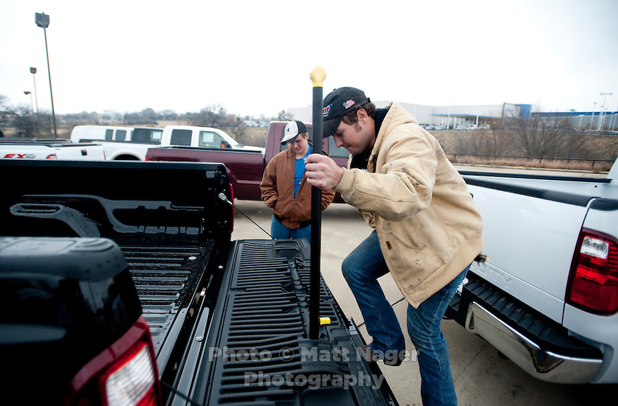 Sam Bartlett (cq, left) and Carl Tanner (cq) check out a new F250 Ford truck at Bankston Ford in Frisco, Texas, Thursday, Jan., 28, 2009. Ford reported gains in earnings for the first time in four years...PHOTOS/ Matt Nager