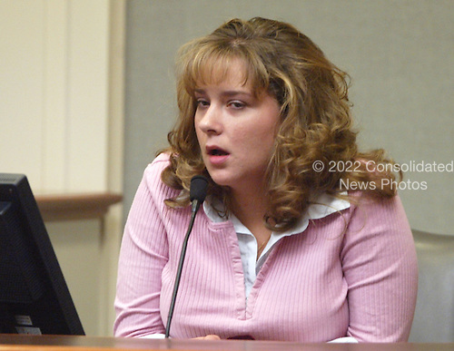 First defense witness, Jane Bolling, a manager of the U.S. Inn Motel, testifies during the trial of sniper suspect John Allen Muhammad in the Virginia Beach Circuit Court in Virginia Beach, Virginia on November 12, 2003.  <br /> Credit: Lawrence Jackson - Pool via CNP