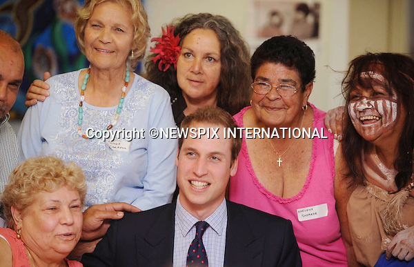 """PRINCE WILLIAM.Prince William on the first day of his tour in Australia visited the City Of Sydney's Redfern Community Centre where he spent time with children aged between 5-12 years old, reading """"Possum Magic"""" to them and playing Nintendo Wii bowling in which he got a spare. The Prince also played table tennis, listened to some live music and received a number of gifts. All after a Traditional aborigine welcome where eucalyptus leaves are burnt in front of himThe City Of Sydney's Redfern Community Centre a dynamic inner-city facility that attracts approximately 4000 people a month and provides a wide range of invaluable services and programs to the local community. Sydney, Australia_19/01/2010..Mandatory Credit Photo: ©DIAS-NEWSPIX INTERNATIONAL..**ALL FEES PAYABLE TO: """"NEWSPIX INTERNATIONAL""""**..IMMEDIATE CONFIRMATION OF USAGE REQUIRED:.Newspix International, 31 Chinnery Hill, Bishop's Stortford, ENGLAND CM23 3PS.Tel:+441279 324672  ; Fax: +441279656877.Mobile:  07775681153.e-mail: info@newspixinternational.co.uk"""