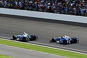 May 28th Indianapolis Speedway, Indiana, USA;  Max Chilton, driver of the #8 Chip Ganassi Racing Honda, and Takuma Sato, driver of the #26 Andretti Autosport Honda, battle for position late in the Indianapolis 500 on May 28th, 2017, at the Indianapolis Motor Speedway in Indianapolis, Indiana.