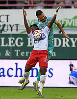 KORTRIJK , BELGIUM - AUGUST 03 : Gjoko Zajkov of Charleroi pictured in a fight for the ball with Imoh Ezekiel of Kortrijk during the Jupiler Pro League match day 2 between Kv Kortrijk and Sporting Charleroi on August 03 , 2019 in Kortrijk , Belgium . ( Photo by David Catry / Isosport )