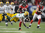 Green Bay Packers receiver Greg Jennings dives for a first down after a long catch and run following handoff to Brandon Jackson and pitch back to quarterback Aaron Rodgers against the Atlanta Falcons during the third quarter of the game at the Georgia Dome in Atlanta, Ga., on Nov. 28, 2010.