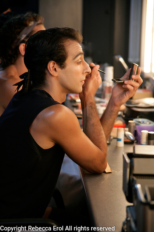 Royal Ballet dancer Jose Martin applies make up backstage for the role of Lescaut in Manon