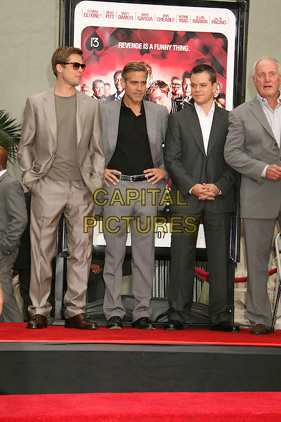 "BRAD PITT, GEORGE CLOONEY, MATT DAMON & JERRY WEINTRAUB.""Ocean's Thirteen"" Handprint and Footprint Ceremony held  at Grauman's Chinese Theatre, Hollywood, California, USA..June 5th, 2007.full length suit jacket black shirt grey gray hands on hips beige sunglasses shades .CAP/ADM/RE.©Russ Elliot/AdMedia/Capital Pictures"