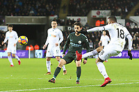 Jordan Ayew of Swansea City crosses the ball into the box during the Premier League match between Swansea City and Manchester City at the Liberty Stadium, Swansea, Wales, UK. Wednesday 13 December 2017
