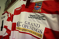 A Kingstonian shirt hangs in the dressing room before the arrival of the players during Kingstonian vs AFC Fylde, Emirates FA Cup Football at King George's Field on 30th November 2019