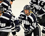 11 February 2011: University of New Hampshire Wildcat forward Nicole Gifford, a Freshman from Peterborough, Ontario, smiles after a goal is scored against the University of Vermont Catamounts at Gutterson Fieldhouse in Burlington, Vermont. The Lady Catamounts defeated the visiting Lady Wildcats 4-2 in Hockey East play. Mandatory Credit: Ed Wolfstein Photo