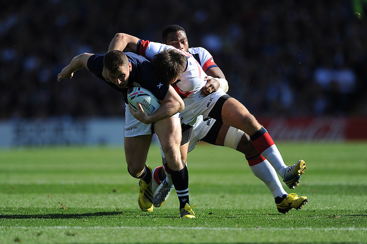 Mark Bennett of Scotland is tackled by Andrew Durutalo of USA during Match 18 of the Rugby World Cup 2015 between Scotland and USA - 27/09/2015 - Elland Road, Leeds<br /> Mandatory Credit: Rob Munro/Stewart Communications