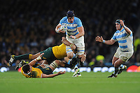 Tomas Lavanini of Argentina barges through Kane Douglas and Sekope Kepu of Australia during the Semi Final of the Rugby World Cup 2015 between Argentina and Australia - 25/10/2015 - Twickenham Stadium, London<br /> Mandatory Credit: Rob Munro/Stewart Communications