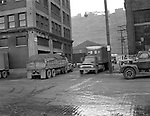 Pittsburgh PA - View of the produce yards Smallman and 17th Streets during the early morning rush - 1956.  On location assignment for Commonnwealth Realty, selling the Thorofare warehouse building