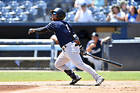 Charleston RiverDogs Frederick Cuevas (1) swings at a pitch during a game against the Asheville Tourists at McCormick Field on August 18, 2019 in Asheville, North Carolina. The Tourists defeated the RiverDogs 6-5. (Tony Farlow/Four Seam Images)