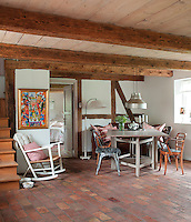 The handmade brick flooring continues into the spacious dining area of the kitchen/dining wing of the barn