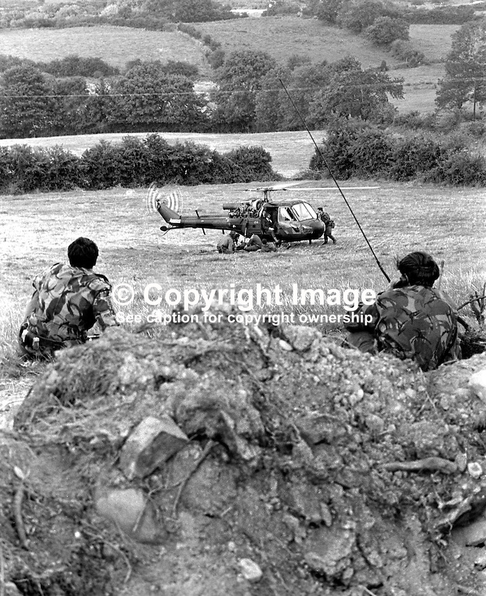 Scene of Provisional IRA explosion at British Army observation post two miles from Crossmaglen, Co Armagh, N Ireland, in which 2 soldiers died and 2 others were injured. The part-time post had been checked out for booby trap bombs but none had been detected. Two soldiers provide cover for the rescue helicopter which flew in for the dead and injured. The soldiers who died were Marine Michael Southern and Corporal Dennis Leach. 197408130442a..Copyright Image from Victor Patterson, 54 Dorchester Park, Belfast, UK, BT9 6RJ..Tel: +44 28 9066 1296.Mob: +44 7802 353836.Voicemail +44 20 8816 7153.Skype: victorpattersonbelfast.Email: victorpatterson@me.com.Email: victorpatterson@ireland.com (back-up)..IMPORTANT: If you wish to use this image or any other of my images please go to www.victorpatterson.com and click on the Terms & Conditions. Then contact me by email or phone with the reference number(s) of the image(s) concerned.
