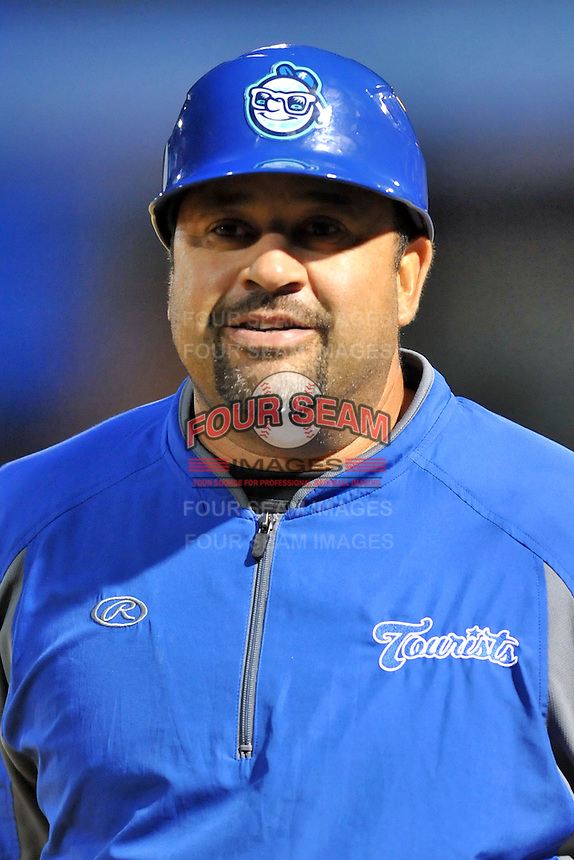 Asheville Tourists manager Fred Ocasio #28 during a game between the Hickory Crawdads and the Asheville Tourists at McCormick Field on April 17, 2013 in Asheville, North Carolina. The Crawdads won the game 6-5. (Tony Farlow/Four Seam Images).
