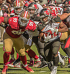 San Francisco 49ers defensive end DeForest Buckner (99) tackles Tampa Bay Buccaneers running back Jacquizz Rodgers (32) on Sunday, October 23, 2016, at Levis Stadium in Santa Clara, California. The Buccaneers defeated the 49ers 34-17.