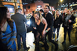 "© Joel Goodman - 07973 332324 . 17/12/2016 . Manchester , UK . A couple smile as they pass along Deansgate Locks . Revellers out in Manchester City Centre overnight during "" Mad Friday "" , named for being one of the busiest nights of the year for the emergency services in the UK . Photo credit : Joel Goodman"
