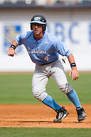 Garrett Gore #4 of the North Carolina Tar Heels takes his lead off of first base versus the Clemson Tigers at Durham Bulls Athletic Park May 23, 2009 in Durham, North Carolina. The Tigers defeated the Tar Heals 4-3 in 11 innings.  (Photo by Brian Westerholt / Four Seam Images)