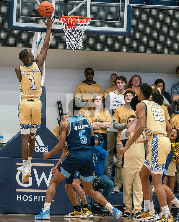 WASHINGTON, DC - FEBRUARY 8: Shawn Walker Jr. #1 of George Washington goes up  for a shot during a game between Rhode Island and George Washington at Charles E Smith Center on February 8, 2020 in Washington, DC.