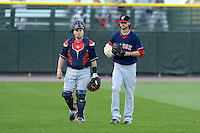 Pawtucket Red Sox pitcher Clay Buchholz (11), on rehab assignment from the Boston Red Sox, and catcher Christian Vazquez (17) walk to the dugout from the bullpen before an International League playoff game against the Rochester Red Wings on September 5, 2013 at Frontier Field in Rochester, New York.  Pawtucket defeated Rochester 7-2.  (Mike Janes/Four Seam Images)