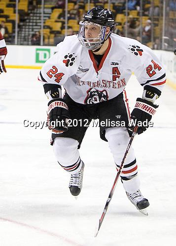 Drew Daniels (Northeastern - 24) - The Harvard University Crimson defeated the Northeastern University Huskies 3-2 in the 2012 Beanpot consolation game on Monday, February 13, 2012, at TD Garden in Boston, Massachusetts.