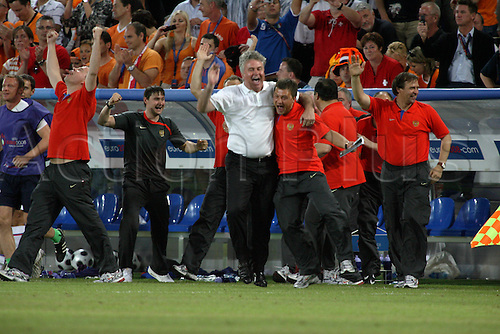 21 June 2008: Russian manager Guus Hiddink celebrates with his staff after the UEFA Euro 2008 Quarter Final game between Russia and The Netherlands played at St. Jakob Park, Basle. Russia won the game 3-1 after extra time Photo: Action Plus....080621 soccer football european championships basel holland coach joy celebration winner