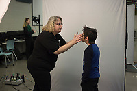 NWA Democrat-Gazette/CHARLIE KAIJO Life Touch photographer Robin Rankin adjusts the glasses of Sebastian Albertos, 11, during spring picture day, Monday, February 4, 2019 at Creekside Middle School in Bentonville.<br />