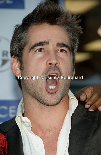 Colin Farrell arriving at the MIAMI VICE Premiere at the Westwood Village Theatre  In Los Angeles. July 20, 2006.<br /> headshot<br /> big mouth open