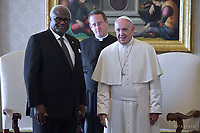 Pope Francis talks with President of Sierra Leone Ernest Bai Koroma during a private audience at the Vatican, on November 11, 2017.
