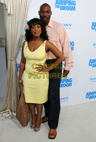 "NIECY NASH & JAY TUCKER.""Jumping The Broom"" Los Angeles Premiere Held At The Arclight Cinerama Dome Theatre, Hollywood, California, USA..May 4th, 2011.full length yellow dress hand on hip black trousers pink shirt couple .CAP/ADM/KB.©Kevan Brooks/AdMedia/Capital Pictures."