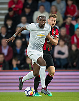 Paul Pogba of Man Utd holds off Simon Francis of AFC Bournemouth during the Premier League match between Bournemouth and Manchester United at the Goldsands Stadium, Bournemouth, England on 18 April 2018. Photo by Andy Rowland.