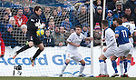 Rangers keeper Neil Alexander drops the ball but manages to recover and scramble it to safetey