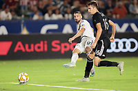 CARSON, CA - SEPTEMBER 15: Sebastian Lletget #17 of the Los Angeles Galaxy takes a shot during a game between Sporting Kansas City and Los Angeles Galaxy at Dignity Health Sports Complex on September 15, 2019 in Carson, California.