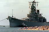 People gather on the beach to see the battleship USS Missouri (BB 63) enter the channel into Pearl Harbor, Hawaii, on June 22, 1998.  United States Secretary of the Navy John H. Dalton signed the Donation Agreement on May 4th, allowing Missouri to be used as a museum near the Arizona Memorial.  The ship was towed from Bremerton, Washington.                                                    <br /> Mandatory Credit: David Weideman / U.S. Navy via CNP