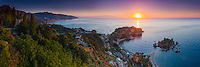 Panoramic photo of the Sicilian Coast at sunrise, showing Isola Bella Beach, Taormina, Sicily, Italy, Europe. This is a panoramic photo of the Sicilian Coast at sunrise, showing Isola Bella Beach, Taormina, Sicily, Italy, Europe. Isola Bella Beach is the most popular beach at Taormina and is a fantastic spot for panoramic views of sunrise over the Ionian Sea (part of the Mediterranean Sea).