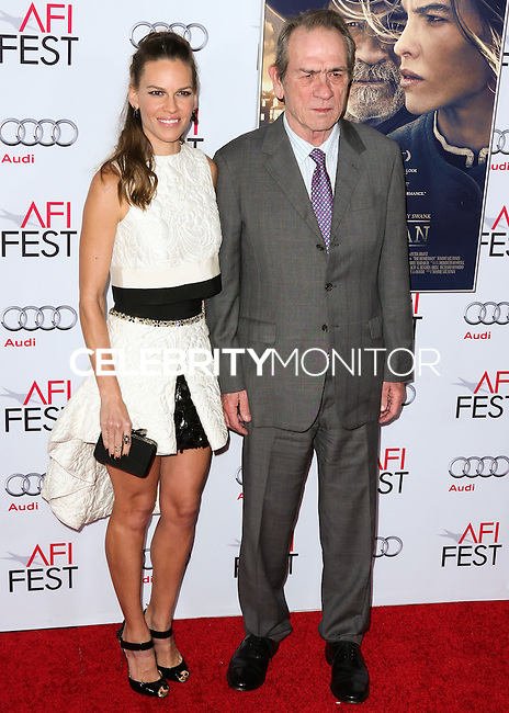 HOLLYWOOD, LOS ANGELES, CA, USA - NOVEMBER 11: Actress Hilary Swank and Actor Tommy Lee Jones arrive at the AFI FEST 2014 - 'The Homesman' Gala Screening held at the Dolby Theatre on November 11, 2014 in Hollywood, Los Angeles, California, United States. (Photo by Xavier Collin/Celebrity Monitor)