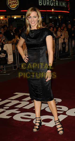 """GABBY LOGAN .World Premiere of """"The Damned United"""" at the Vue West End, Leicester Square, London, England..March 18th 2009.full length gaby black dress patent cuff hand on hip bracelet strappy shoes sandals open toe.CAP/CAN.©Can Nguyen/Capital Pictures."""
