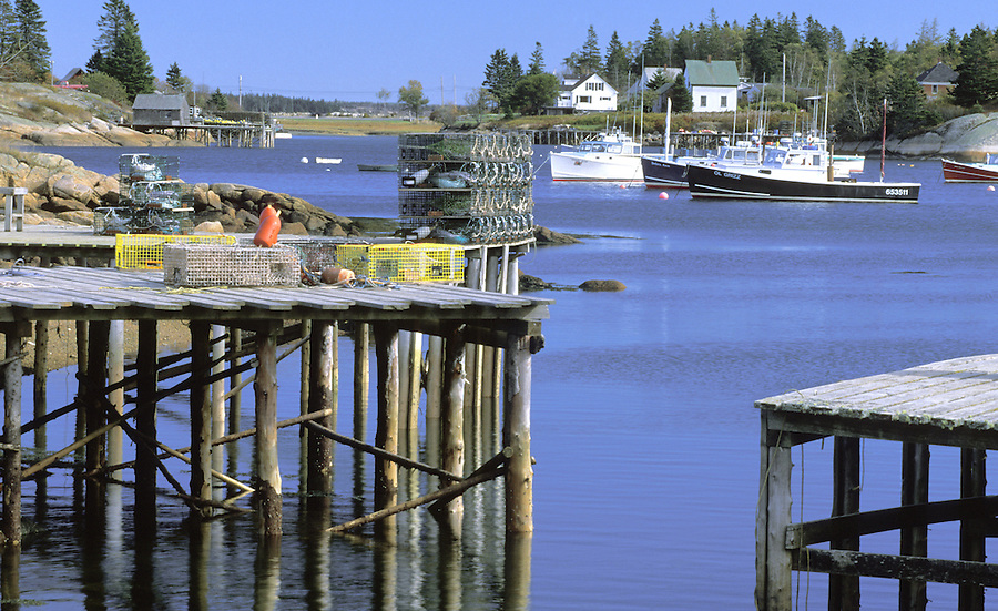 Fishing boats and piers in harbor, Corea, Maine