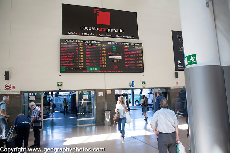 Man looking at information board about bus arrivals and departures, Granada bus station, Spain
