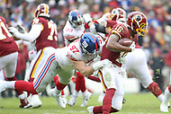 Landover, MD - December 9, 2018: New York Giants defensive end Josh Mauro (97) tackles Washington Redskins wide receiver Jehu Chesson (16) during the  game between New York Giants and Washington Redskins at FedEx Field in Landover, MD.   (Photo by Elliott Brown/Media Images International)