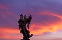 Italy, Rome, statue of an angel on Ponte Sant Angelo with colorful sky