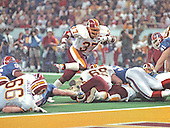 Washington Redskins running back Gerald Riggs (37) scores has second touchdown early in the third quarter against the Buffalo Bills during Super Bowl XXVI in Minneapolis, Minnesota on January 26, 1992.  The Redskins won the game and the World Championship 37 - 24.<br /> Credit: Howard L. Sachs / CNP